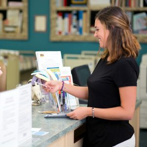Woman Using Library Card