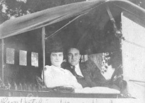 1930-1939 Couple (Madelyn Hutchins & James Harkness) sitting in an automobile
