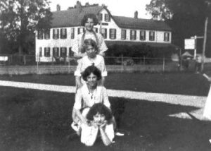 1930-1939 Four girls on courthouse lawn