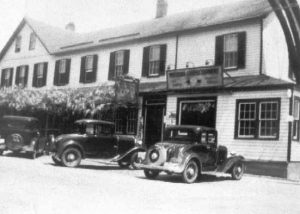 1930-1939 Hotel Calvert with three automobiles in front, Prince Frederick, Md