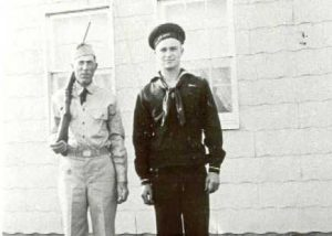 1940-1949 Paul Montgomery in the uniform of Charles County Minutemen, and William Bassford in Navy uniform