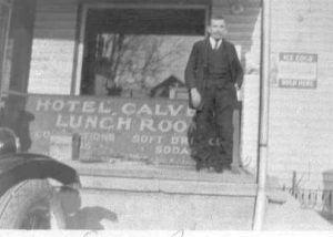 1930-1939 Man (Eugene Bowen) in front of Hotel Calvert Lunch room
