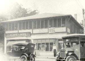 1920-1929 Ewald's Grocery and A&P at 7th and Bay Ave. Bus to Chesapeake Beach rounding corner, North Beach.