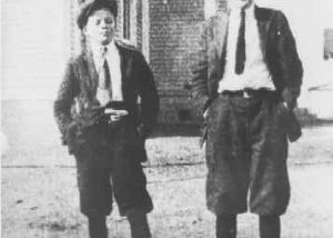 Two boys in front of Prince Frederick High School.